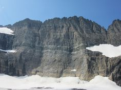 "The Neoproterozoic Purcell Sill is a stark, obvious black stripe in the strata of Glacier National Park. Here it is emerging from behind ""The Salamander"" glacier, above Grinnell Glacier Cirque"