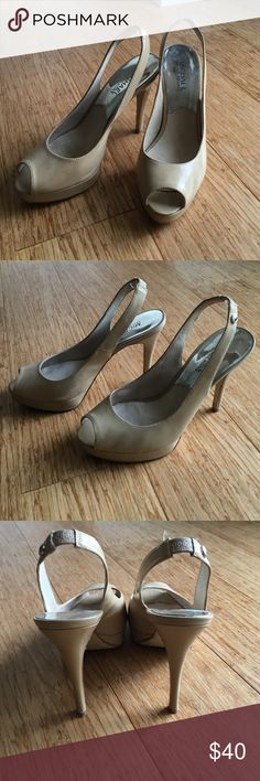 MICHAEL Michael Kors Nude Patent Slingback Heels These platform stiletto sling backs are fabulous! Perfect for summer dresses. Great condition with minimal scuffs. Super comfortable. 4 1/2 inch heel. MICHAEL Michael Kors Shoes Heels