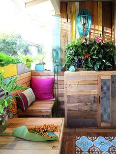 Believe it or not, the wooden panels of this tropical retreat conceal the generic and uninspired patio of a rental. Without drilling into the walls or painting any existing surfaces, Ananda of A Piece of Rainbow managed to transform her outdoor space using cleverly placed pallets and a fair amount of elbow grease.