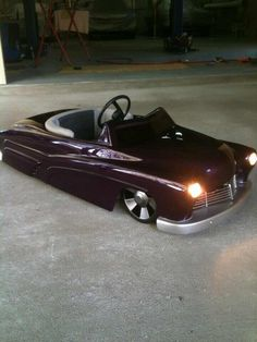 Cute pedal car, with lights no less... SealingsAndExpungements.com... 888-9-EXPUNGE (888-939-7864)... Free evaluations..low money down...Easy payments.. 'Seal past mistakes. Open new opportunities.'