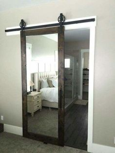 A barn door sliding mirror . . . such a great idea!