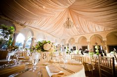 Photo via Project Wedding - this ceiling tent treatment with fabric is so beautiful.  Love the way the fabrics give such a soft look to the event space.  Satins and silks are very versatile.