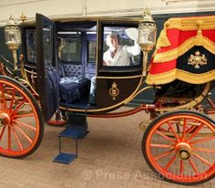 Carriage Restorer Dave Evans cleans the Glass Coach at the Royal Mews, Buckingham Palace, via Flickr.