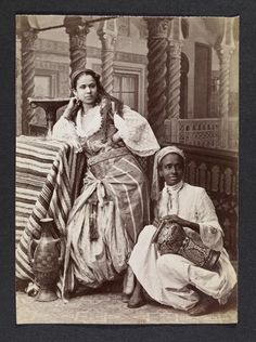 Young woman and man posed against studio backdrop… 19th century- Algiers  Orientalist Photography Aleria
