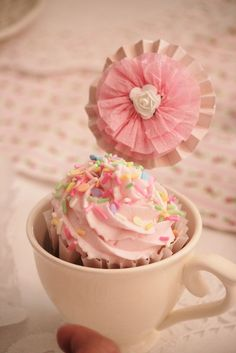 tea party - love pink cup cakes in tea cups as a place setting. Instead of the umbrella, imagining a name label for where each person will sit