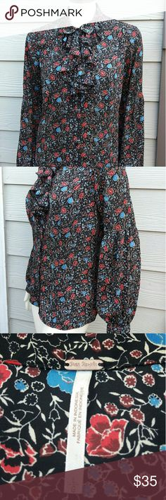 "Free People Floral Shirt Blouse Free People Womens Sz Large Black Ruffle Floral Button Down Shirt Bishop Sleeves Length:26"" Bust:19 "" Gently used with no flaws. Please see photos for exact details. Thank you for patronizing us. Free People Tops Button Down Shirts"