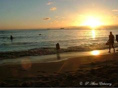 """Puanani E: I took this photo on Waikiki Beach, Oahu.  It's a """"sky"""" picture.  The entire sunset area appears to be a likeness of """"Jesus"""" in my eyes. I get """"chills"""" every time I look at it. The brightest  area above the horizon would be the forehead; then tapers vertically down as the nose; you can see eyes around that area if you focus; as you look downwards you can see a formation of a mouth in the water; further down the chin is the brightness area in the sand in front of the woman walking."""