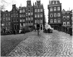1954. Social worker on bicycle on the bridge over the Oudezijds Voorburgwal near the Oude Kennissteeg. Photo AHF collection IISH, Amsterdam/Ben van Meerendonk. #amsterdam #1954