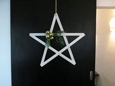 I like to make some new Christmas decor every year! I came up with a wooden star to hang on the front door or on the wall. It's quite simple to make and very budget… Diy Christmas Star, Christmas Holidays, Christmas Ornaments, Modern Christmas, Christmas Ideas, Inflatable Christmas Decorations, Star Decorations, Best Front Doors, Diy Coat Rack