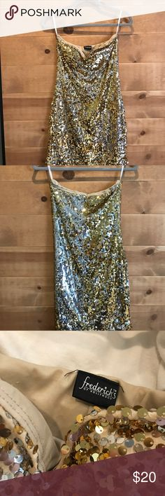 Fredericks of Hollywood Gold/Silver Sequin dress This strapless party dress is perfect or Las Vegas, downtown, 21st birthday or costume. It's lined inside so it's very comfortable and not itchy. I always got tons of compliments on it! It's stretchy also so it's likely to fit many body types. No size on it but I'm 5'10' and 140 and loved it! I don't party anymore so it's up for grabs! Frederick's of Hollywood Dresses Strapless