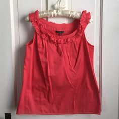 Kristin Davis coral cotton blouse This top is perfect for a work setting or dressy casual function. Fully lined; 100% cotton. Kristin Davis Tops Blouses