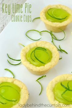 Key Lime Pie Cookie Cups: Made with store bought sugar cookies and filled with a delicious lime curd. Perfect for your next barbecue! Using a store bough Pillsbury Cookie Dough, Pillsbury Sugar Cookies, Sugar Cookie Cups, Cookie Pie, Cookie Desserts, Fun Desserts, Delicious Desserts, Vegetarian Desserts, Fun Easy Recipes