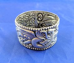 Veiled Prophet sterling napkin ring, 1900 St. Louis ball, repousse work by tlgvintageart on Etsy