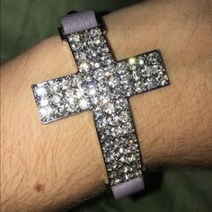 LAST CHANCE!! Cross Wrap Bracelet Silver with diamond cross (all diamonds are in tact) with a dark grey band. Silver hardware throughout the piece. Perfect condition. Brand new. Never worn. Very easy to accessorize with other jewelry. Not looking to trade. Jewelry Bracelets