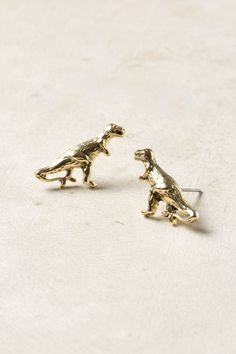 Playful earrings always add extra flare and personality to any look...and who wouldn't want dinosaur ear rings?