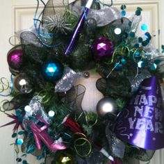a Christmas Wreath with shiny and glittery pieces'- can also be easily transformed into a piece that can welcome your guests at your door for your New Years Eve party.