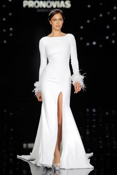Irina Shayk in a @Pronovias Nuria gown made of crepe, embroidery and feathers.