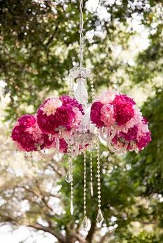 Looking for a modern twist on a classic silhouette? Consider using floral chandeliers.  Indoors or out these give your event a vintage elegance which is perfect for weddings.