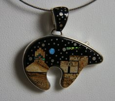 This is a beautiful Calvin Begay bear pendant for sale on Santa Fe Rose
