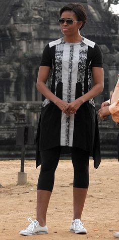 Michelle Obama's Best Looks Ever - 2015 – BCBG Max Azria from #InStyle | Obama stopped by the historical Angkor Wat temple in Cambodia wearing a paneled BCBG Max Azria dress, which she finished with leggings and classic Converse sneakers.