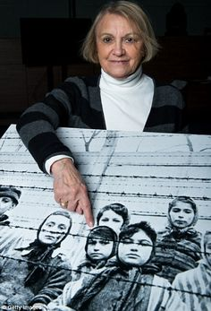 Paula Lebovics survived the camp and points at herself on a picture taken the day the camp was liberated