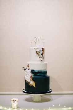 elegant navy and gold wedding cake