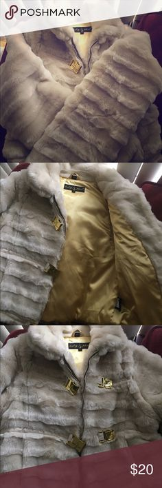 Baby phat coat Puffy baby phat coat with gold accents and gold fux fur Baby Phat Jackets & Coats