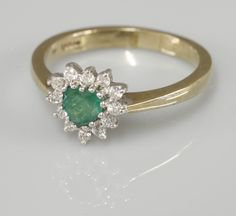 A 9ct gold heart shaped emerald and diamond cluster ring Sold for £120 2nd December 2015