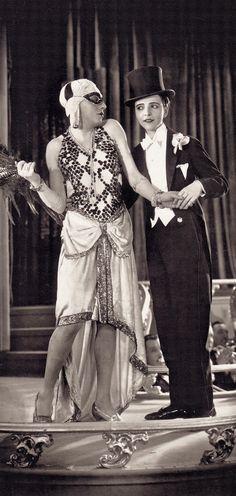 Der Fürst von Pappenheim 1927. (The Masked Mannequin) Curt Bois cross dresses as a fashion model, while Mona Maris plays his dapper escort (detail)  From Sirens & Sinners : A visual history of Weimar Film 1918-1933 by Hans Helmut Prinzler (2013)
