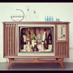 Vintage 1967 Zenith TV tuned into a bar