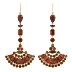 Pair of Antique Gold and Foiled-Back Garnet Pendant-Earrings Topped by a line of 16 pear, marquise-shaped and round foiled-back garnets, suspending fan-shaped panels set with 38 round and 14 fancy-shaped foiled-back garnets, backed in gold. Garnet Jewelry, Garnet Earrings, Pendant Earrings, Silver Jewelry, Victorian Jewelry, Antique Jewelry, Vintage Jewelry, Antique Gold, Victorian Gold