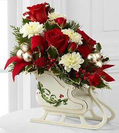 Christmas Flower Arrangement In Christmas Sleigh