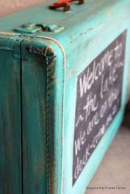 Beyond The Picket Fence: Pack Up Your Troubles...:  Reuse an old suitcase by painting it all over and then covering one side with chalkboard paint.  Could use as family message center, for kids to play, or to announce menu for guests.