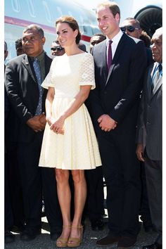 The Duchess pairs her pastel yellow dress with Stuart Weitzman wedges at the Honiara International Airport during the royal couple's Diamond Jubilee Tour.   - ELLE.com