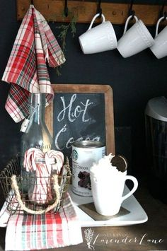 Perfect little hot cocoa bar with candy canes and plaid