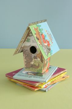 "Turn a craft store birdhouse into a ""fairy tale"" bookhouse as a nursery gift.     Use the jacket as the roof and decoupage the exterior with pages from the inside."
