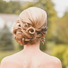 To see more pretty wedding hairstyles: http://www.modwedding.com/2014/11/15/best-wedding-hairstyles-week/ #wedding #weddings #hair #hairstyle  photo: The Melideos