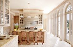 Designer David Easton restored this Palm Beach, Florida, mansion, hanging an Ann-Morris ceiling fixture above the kitchen island and bringing in barstools from TK Collections. RELATED: See More Home Remodeling & Renovation ideas Architectural Digest, Beautiful Kitchens, Cool Kitchens, Dream Kitchens, Before After Kitchen, Estilo Art Deco, Cuisines Design, Traditional Kitchen, Kitchen Backsplash