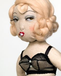 This doll has attitude! ..... Even though cigarettes are no longer fashionable, this lady still is!