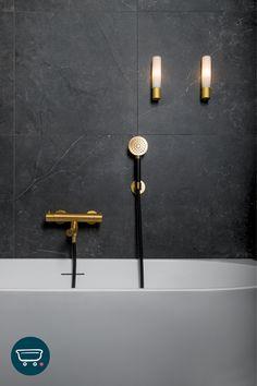 Zwarte wandtegels en geborsteld messing kranen zijn een chique en stoere combinatie in de badkamer. Waan je zo in je eigen hotel-chic-badkamer. En badder in luxe en stijl. De gouden kranen zijn van Hotbath. De badkraan is de Hotbath Buddy thermostatische badmengkraan en de handdouche is de Hotbath Cobber handdouche met wandsteun. Beiden in de uitvoering 'geborsteld messing'. Deze badkamer is te zien in de Sanitairwinkel-showroom in Amsterdam. Sconces, Wall Lights, Lighting, Home Decor, Seeds, Chandeliers, Appliques, Decoration Home, Room Decor