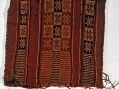 """Flat bag woven in red stripes, alternately decorated in geometric pattern, similar to a game board.    This bag is medium: wool technique: section a) complimentary warp, plain weave; section b) warp-faced plain weave with warp stripes; warp selvage for opening of bag; sides intact.    This bag is from Peru and dated """"1260–1500""""."""