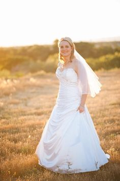 Jenna Holland chose the Maggie Sottero 'Bianca' gown for her wedding to Shelby Caster last June.
