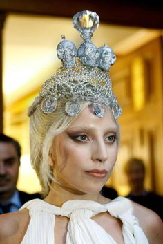 """Kondylatos jewellery featured @ Allure Magazine """"Allure"""" February 2015 Lady Gaga wears Kondylatos Jewellery Lady Gaga made fashion statement appearing outside hotel Grande Bretagne in Athens - Greece on Friday 19 of September wearing a crown made by Pericles Kondylatos. The international superstar chose this Skull crown made by Swarovski crystals, pearls & sculls to complete her look as an alternative ancient Greek caryatid."""