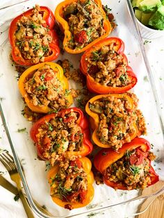 Stuffed Peppers are loaded with healthy ingredients like ground turkey, crushed tomatoes, cauliflower rice, mushrooms, delicious spices and more! Top your peppers off with Avocado Cream Sauce Whole 30 Stuffed Peppers, Paleo Stuffed Peppers, Ground Turkey Stuffed Peppers, Stuffed Pepper Soup, Stuffed Banana Peppers, Healthy Dinner Recipes, Paleo Recipes, Whole Food Recipes, Vegetarian Food