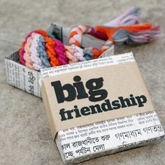 BIG friendship bracelets, what a great present, on an unrelated not I love newspaper as wrapping paper.