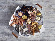 Seafood selection served on a glavanised steel platter Seafood Bisque, Seafood Soup, Seafood Dinner, Seafood Mac And Cheese, Seafood Pizza, Seafood Platter, Seafood Appetizers, Baked Mushrooms, Seafood Market