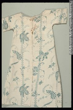 Rear view, child's dress, 1725-1750. Block printed cotton with blue floral pattern.