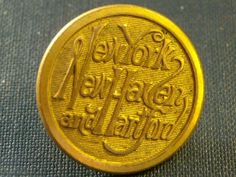 "ANTIQUE BRASS RAILROAD BUTTON~NEW YORK, NEW HAVEN & HARTFORD   antique brass railroad button of the New York, New Haven and Hartford line. Button is in excellent condition and measures 7/8"".   SOLD $36.99"
