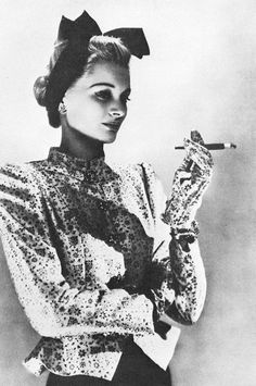 Model wearing a brocade evening jacket by Mainbocher _ Photo by Hoyningen-Huene, Harper's Bazaar, 1939.