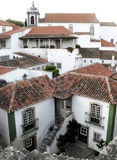 Óbidos is a very nice small medieval village near Leiria, about 100km from Lisbon.